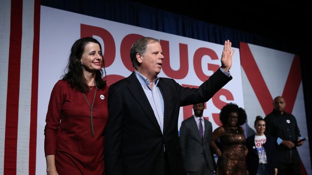 Democratic Senatorial candidate Doug Jones (right) and his wife Louise Jones greet supporters in Birmingham, Alabama, on December 11th, 2017.