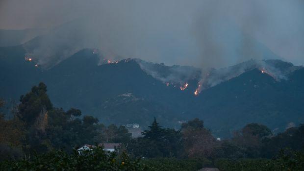 Fires burn across the Romero Canyon hillside in Montecito, California, on December 12th, 2017.
