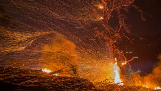 A strong wind blows embers during the Thomas Fire on December 16th, 2017, in Montecito, California.