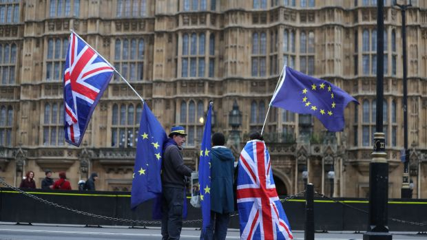 Pro-European Union, anti-Brexit demonstrators hold Union and E.U. flags outside the Houses of Parliament in London on December 21st, 2017.