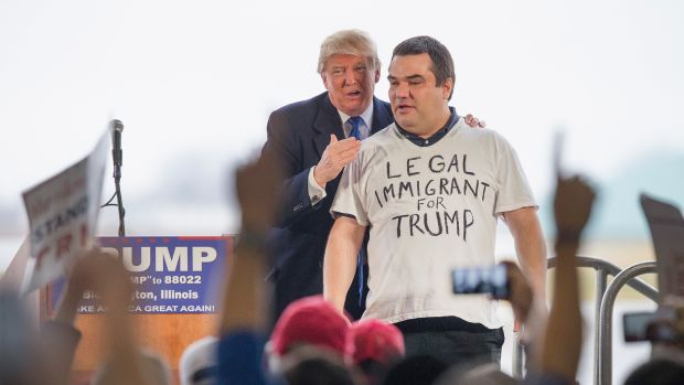 Donald Trump pulls a supporter from a crowd at a rally on March 13th, 2016, in Bloomington, Illinois.