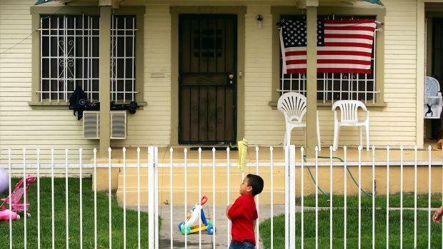 An American flag hangs on a home in Maywood, California.