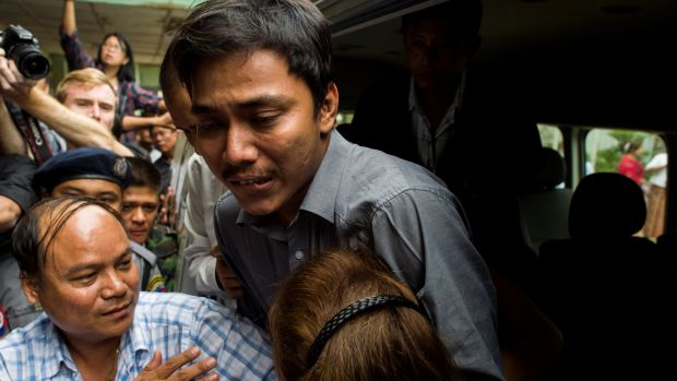 Kyaw Soe Oo, a journalist for the Reuters newswire, hugs his sister upon his arrival at a court in Yangon on December 27th, 2017.