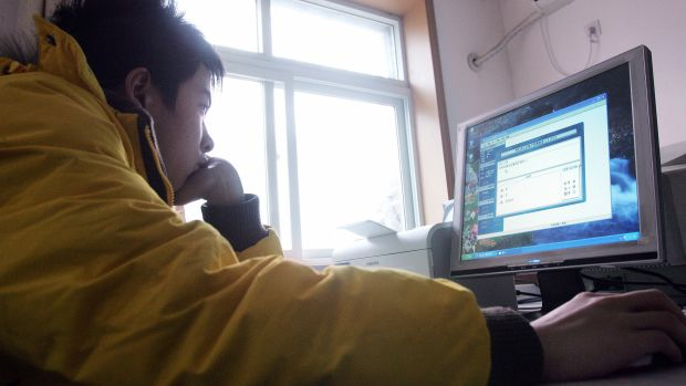 A teenager using a computer.