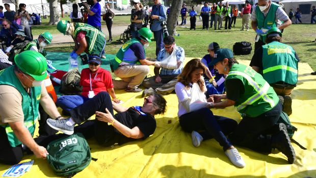 First responders tend to exercise victims, playing the role of earthquake casualties, during the 2017 Great California Shakeout earthquake drill at the Natural History Museum in Los Angeles, California, on October 19th, 2017.