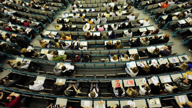 New students sit and wait to be welcomed in one of the lecture halls of the Johannes Gutenberg University in Mainz, Germany, on April 9th, 2008.