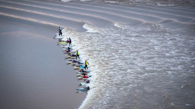 Surfers attempt to ride the Severn Bore on the River Severn on February 2nd, 2018, in Gloucestershire, England. The bore, which follows this week's supermoon, attracts surfers from around the world.