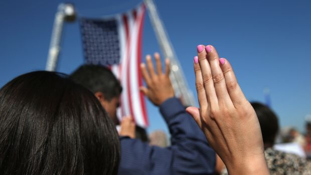 One hundred immigrants become American citizens during a naturalization ceremony at Liberty State Park on September 17th, 2015, in Jersey City, New Jersey.