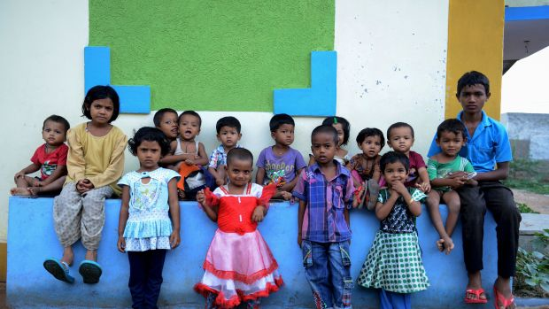 Rohingya Muslim children pose for a photo at a refugee camp in the old city of Hyderabad.
