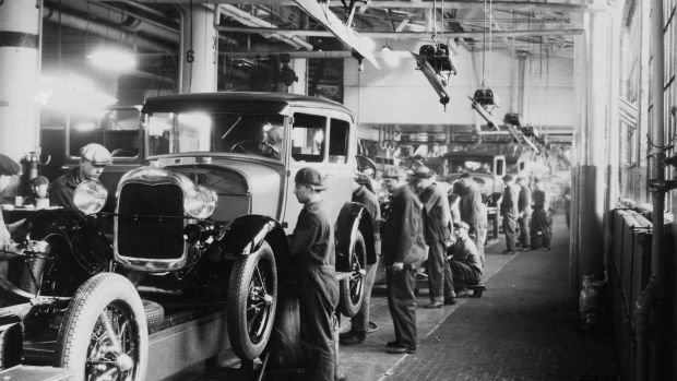Assembly line workers inside the Ford Motor Company factory in Dearborn, Michigan.