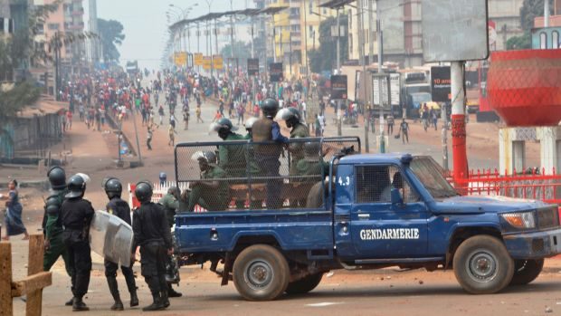 Riot police get ready to disperse people demonstrating to denounce the results of the local elections, on February 6th, 2018, in Conakry, Guinea. Guinean opposition leaders denounced the West African country's long-delayed local elections as fraudulent, citing vote rigging in polling stations across the country.