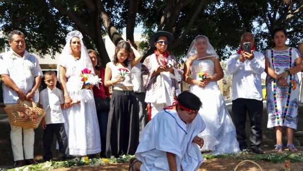A group of environmental activists hold a traditional ceremony during an event called Marry a Tree, in the community of San Jacinto Amilpas, Mexico, on February 25th, 2018. Marry a Tree began as a ritual of giving thanks to Mother Earth carried out by the organization Bedani; it later gave way to a symbolic wedding based on Inca customs where women and men marry trees in a rite led by Peruvian actor and environmentalist Richard Torres.
