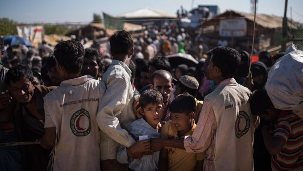 Rohingya Muslim refugees queue for aid suplies at the Kutupalong camp on December 4th, 2017.