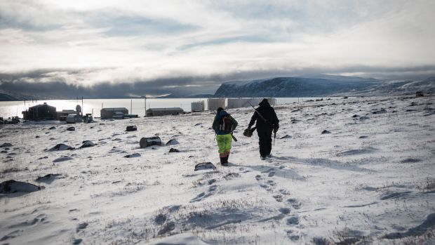 Markoosi and Nanasi Illauq walk to Clyde River's tiny harbor to set off for a day of hunting. For many Inuit, hunting represents a link to millennia of tradition—but those links are rapidly weakening in a changing climate.