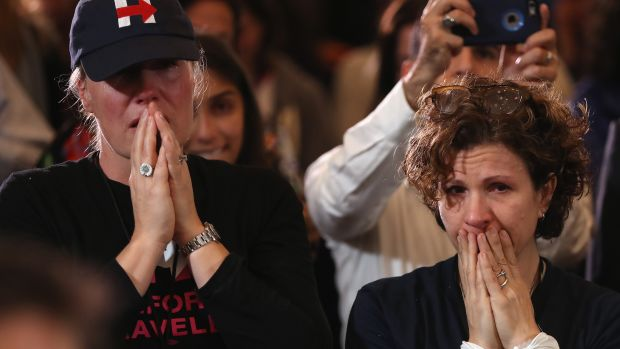 Staffers and supporters react as former Secretary of State Hillary Clinton concedes the presidential election at the New Yorker Hotel on November 9, 2016 in New York City. Republican candidate Donald Trump won the 2016 presidential election in the early hours of the morning in a widely unforeseen upset.