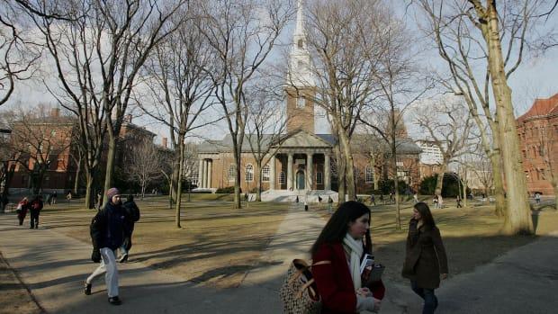 Students walking across the campus at Harvard University.