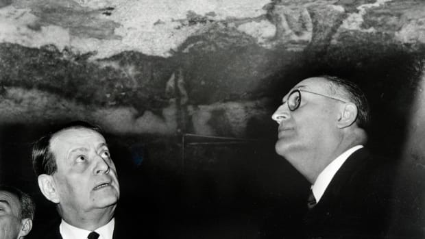French Minister for Culture Andre Malraux (L) looks at the prehistoric paintings during his visits at the Lascaux caves, on March 13th, 1967.