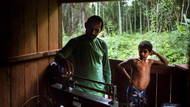 Pedro Pereira, left, at his trading post.