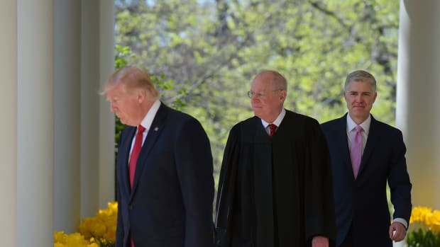 President Donald Trump, Justice Anthony Kennedy, and Neil Gorsuch make their way to the Rose Garden for Gorsuch's swearing-in ceremony as an associate justice of the U.S. Supreme Court at the White House on April 10th, 2017.