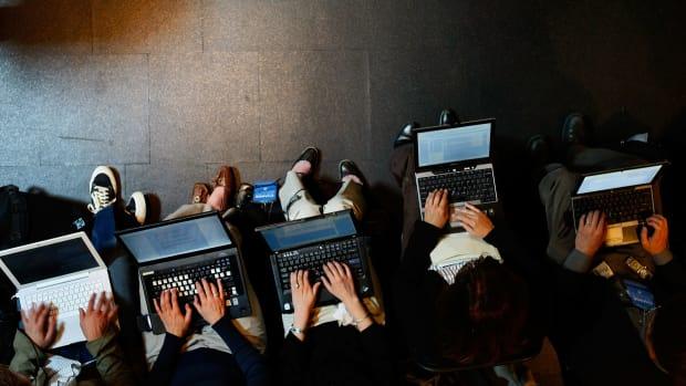 Reporters work on their laptops in Beaverton, Oregon.
