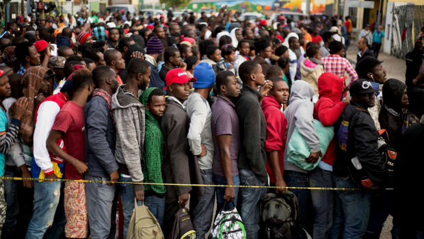 Haitian and African migrants seeking asylum in the United States line up outside a Mexican Migration office on October 3rd, 2016, in Tijuana, Mexico.