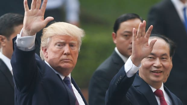 President Donald Trump and Vietnam's President Tran Dai Quang leaves a press conference at the Presidential Palace in Hanoi on November 12th, 2017.