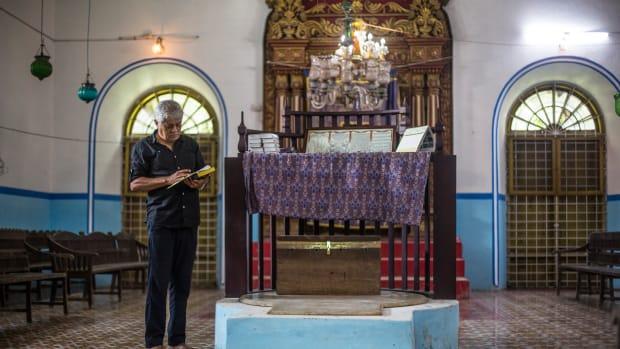 "Josephai ""Babu"" Elias, in Kadavumbhagam Synagogue's prayer hall."