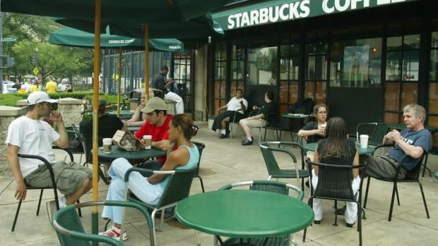 Customers sit outside a Starbucks in Washington, D.C.