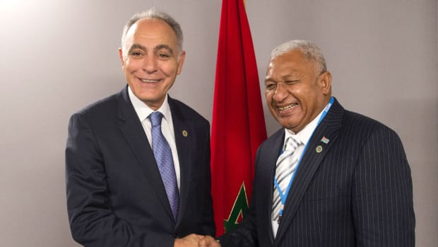 Salaheddine Mezouar (left), the Moroccan minister of foreign affairs, shakes hands with Frank Bainimarama, prime minister of Fiji, at the COP22 climate conference in Marrakech, Morocco, on November 18th, 2016.