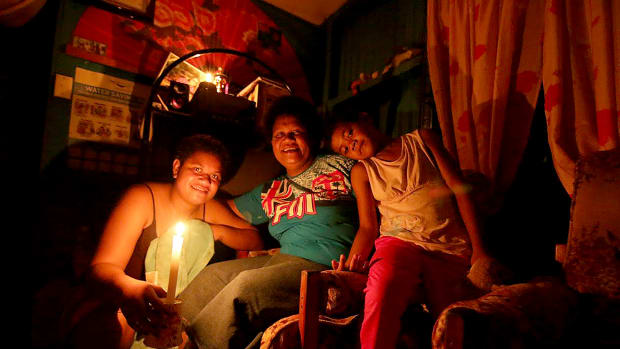 A family weathers the loss of power after Cyclone Winston swept through Fiji in 2016.