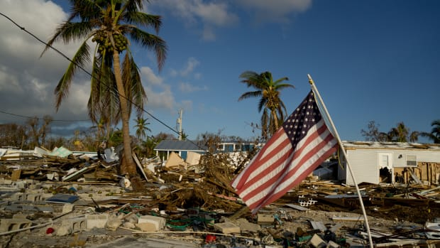 An American flag flies amid the destruction in the Sea Breeze trailer park in Marathon, Florida, on September 16th, 2017.