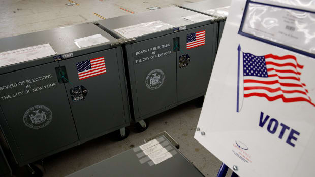 Voting booths and crates containing polling station supplies sit at a New York City Board of Elections voting machine facility warehouse.
