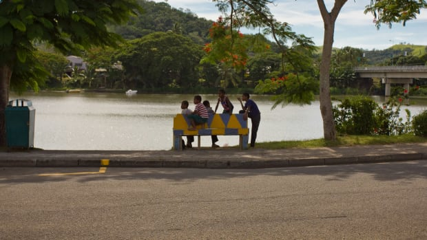 A group of young boys hanging out near the Sigatoka River.