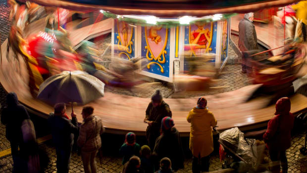 Children ride a merry-go-round on opening day at the Christmas market in Magdeburg, Germany, on November 27th, 2017.