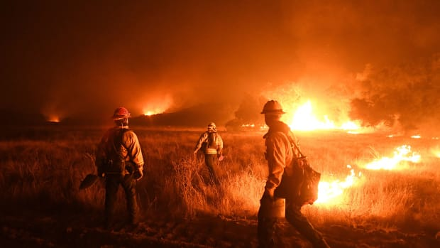Firefighters light backfires as they try to contain the Thomas wildfire, which continues to burn in Ojai, California, on December 9th, 2017.