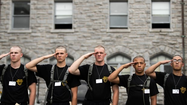 New cadets practice their salute during Reception Day at the United States Military Academy at West Point, on June 27th, 2016, in West Point, New York.