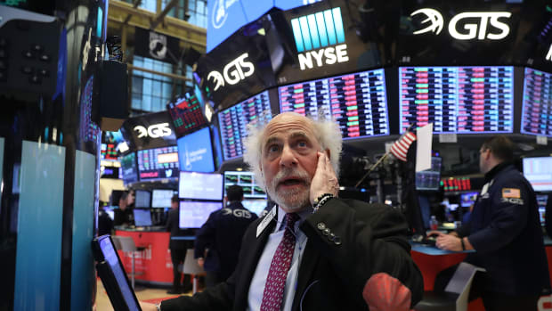 Traders work on the floor of the New York Stock Exchange moments before the closing bell on February 8th, 2018, in New York City.
