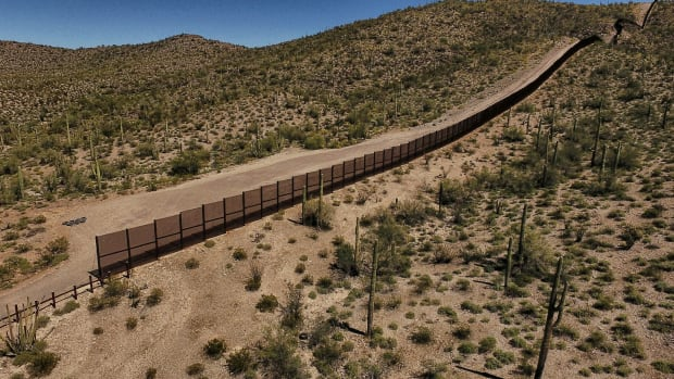 A view of the metal fence along the border between the Altar desert in Mexico and Arizona in the United States.