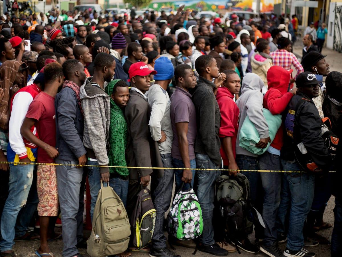 Thousand of Haitians gather outside US embassy seeking asylum from insecurity - Tatahfonewsarena