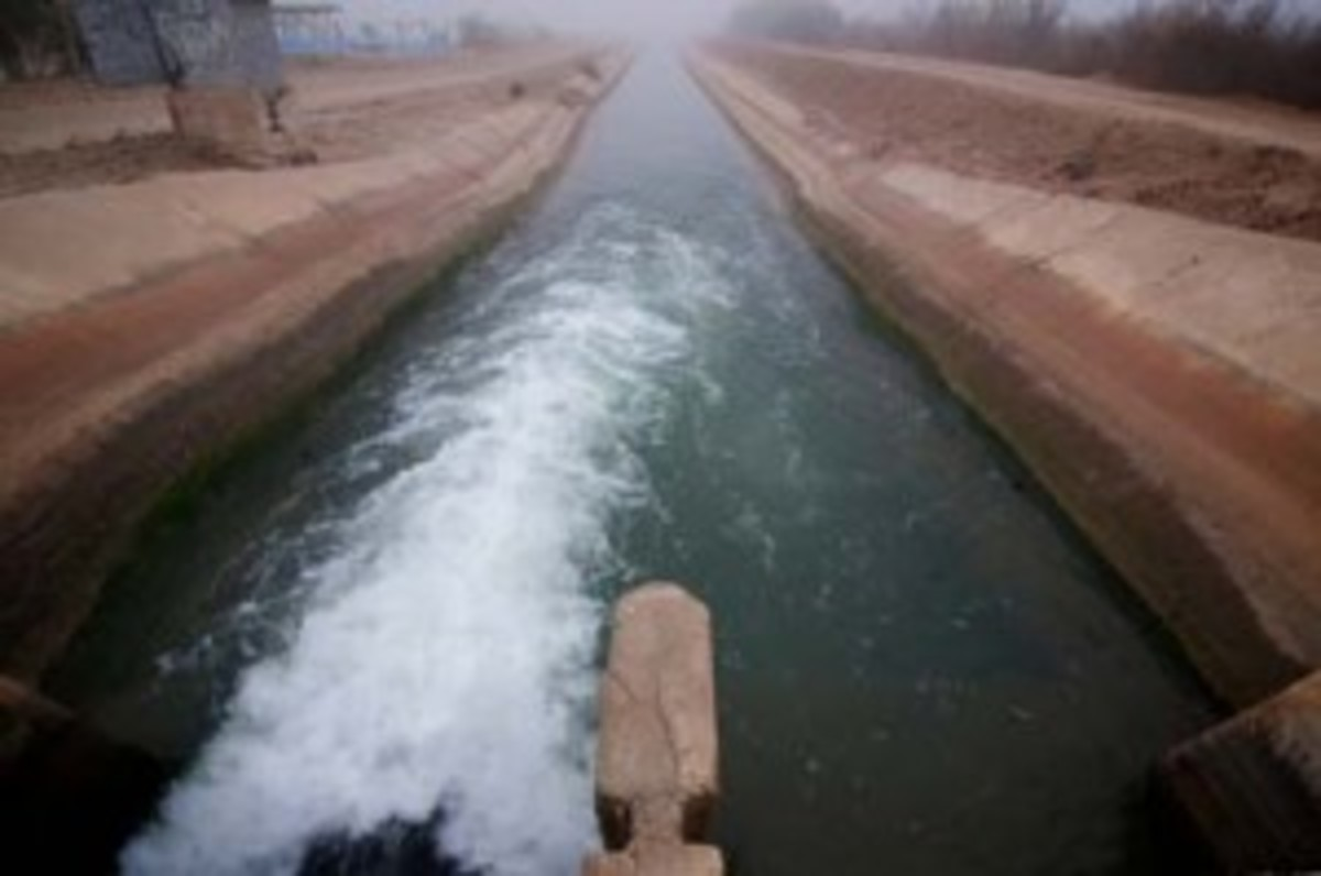 Irrigation canals are used by local farmers to channel water from the Colorado River. While nearly all of the Colorado River's water is used by people, the ever increasing demand for water has made people strain the already taxed waterway. (John Goodman/ZUMA Press)