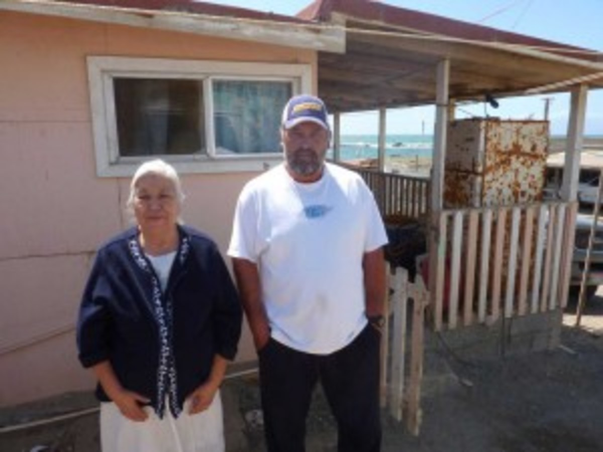 Daniel, a fisherman from Punta Eugenia, and his mother in front of their house. (Kristian Beadle)