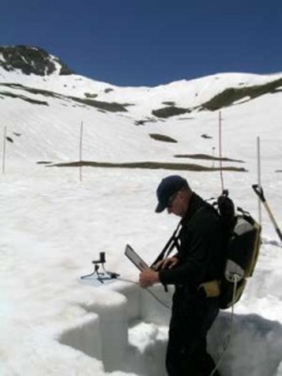 Tom Painter is pictured tracking radiation in June 2007. In melting snow, dust comes to light. (Center for Snow and Avalanche Studies)