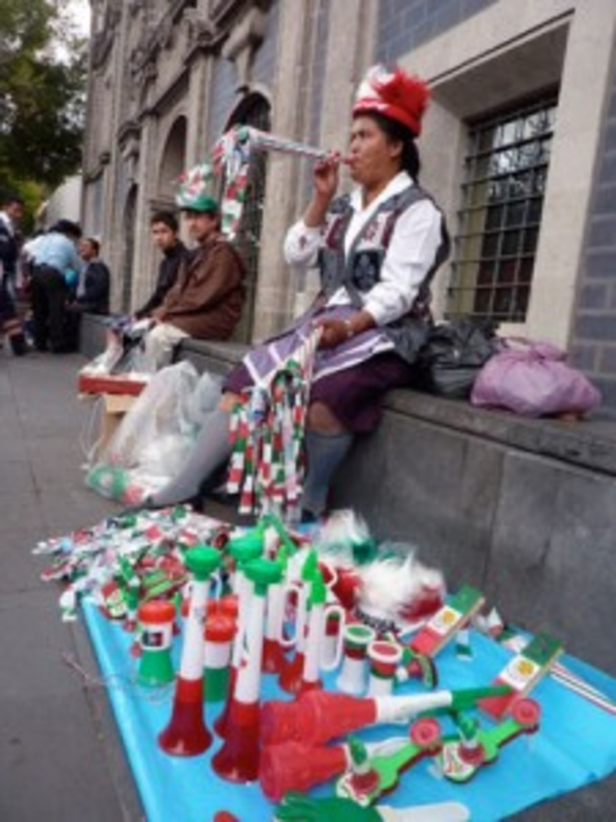 A lady sells souvenirs emblazoned with the colors of Mexico's flag during the country's bicentennial celebrations
