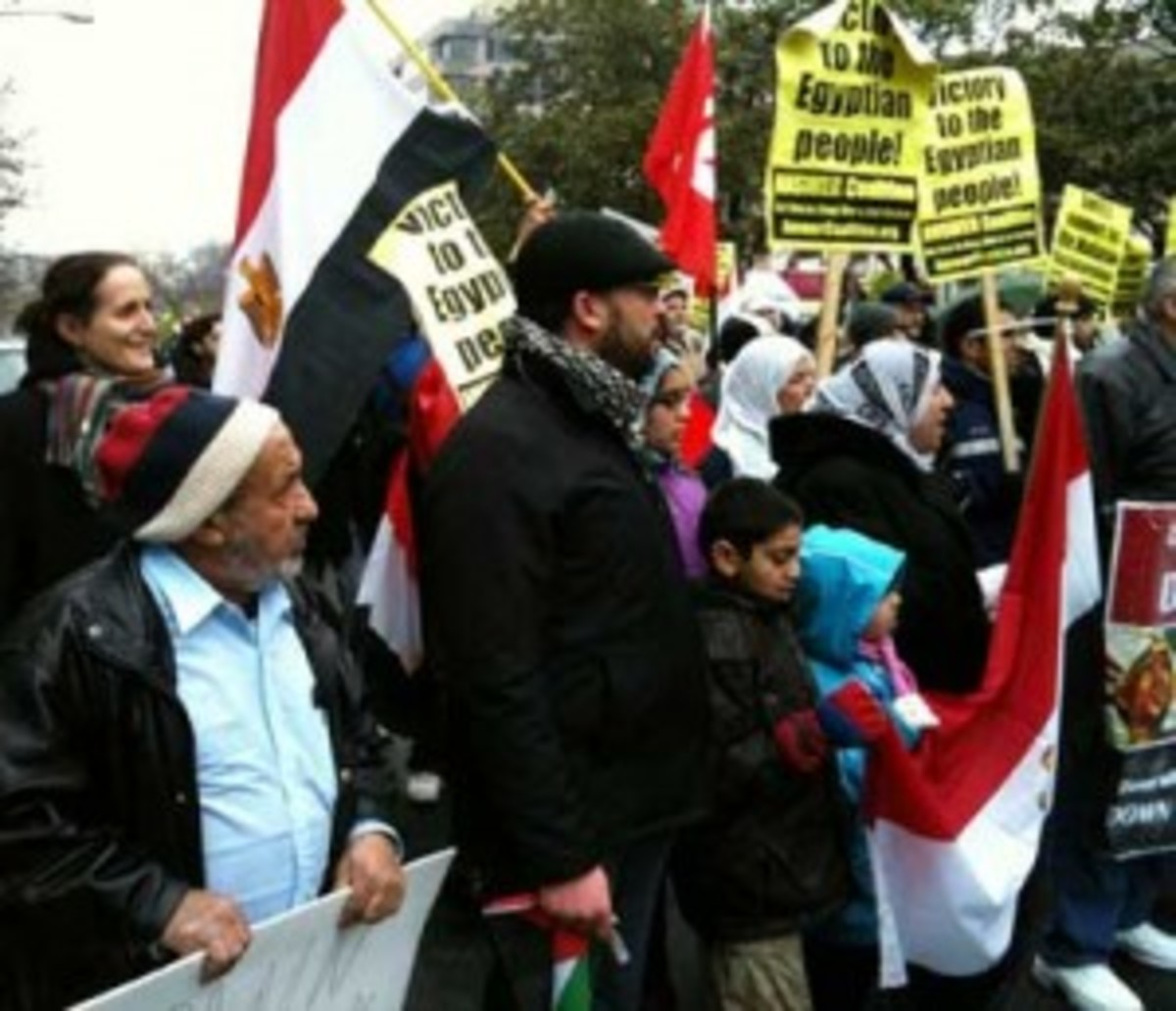"Professor Nivien Saleh, far left in multicolor scarf, pictured at an anti-Mubarak demonstration in Washington, D.C., on Feb 5. Saleh offers the ""Doha Debates"" as one example for Egyptians crafting a new government."