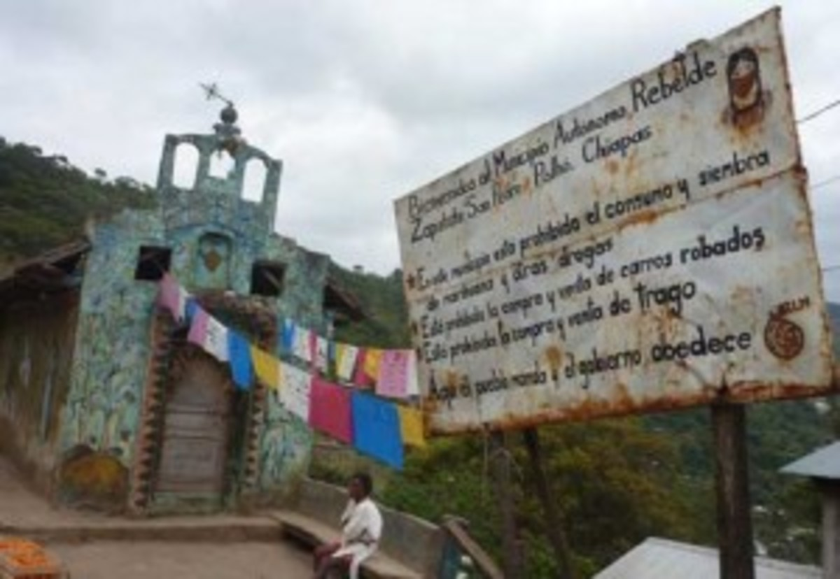 "A church sign reads: ""Welcome to our Autonomous Rebel Zapatista Municipality of San Pedro Polhó, Chiapas. In this municipality it is prohibited the consumption and cultivation of marijuana and other drugs. It is prohibited to buy or sell stollen cars. It is prohibited to buy or sell alcohol. Here the people order and the government is obedient."" (Kristian Beadle)"