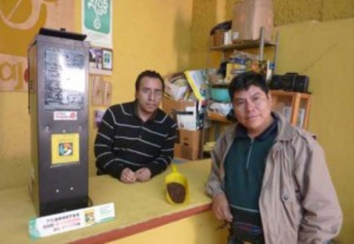 Pictured, Roberto Guzman, right, president of Majomut coffee cooperative, at the office in the outskirts of San Cristobal de las Casas. (Kristian Beadle)