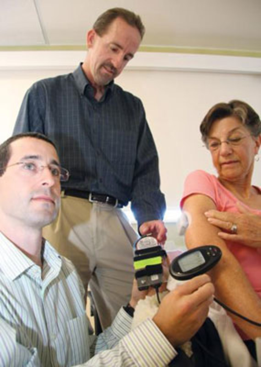 UCSB researchers Frank Doyle, top, and Eyal Dassau, left, with an artificial pancreas patient. (Courtesy of UCSB)