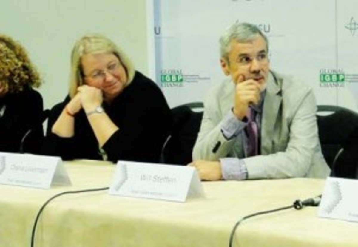 Diana Liverman, geography and development at the University of Arizona, left, and Will Steffen, executive director of the Australian National University's Climate Change Institute speak on a panel during the Planet Under Pressure Conference in London March 27. (Gail Osherenko)