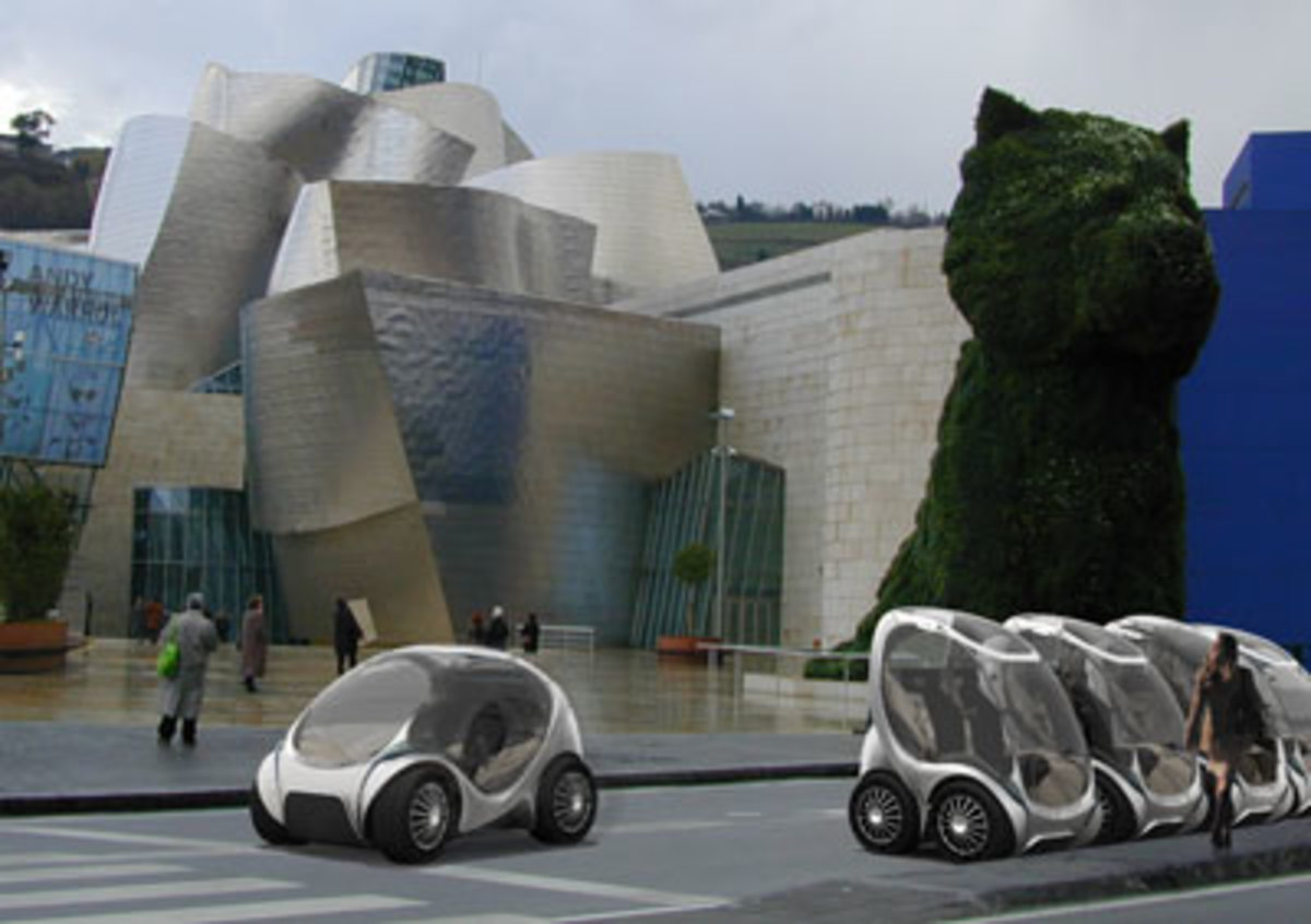 Hiriko CityCars line up outside the Guggenheim Bilbao in this artist's conception of the foldable vehicle.