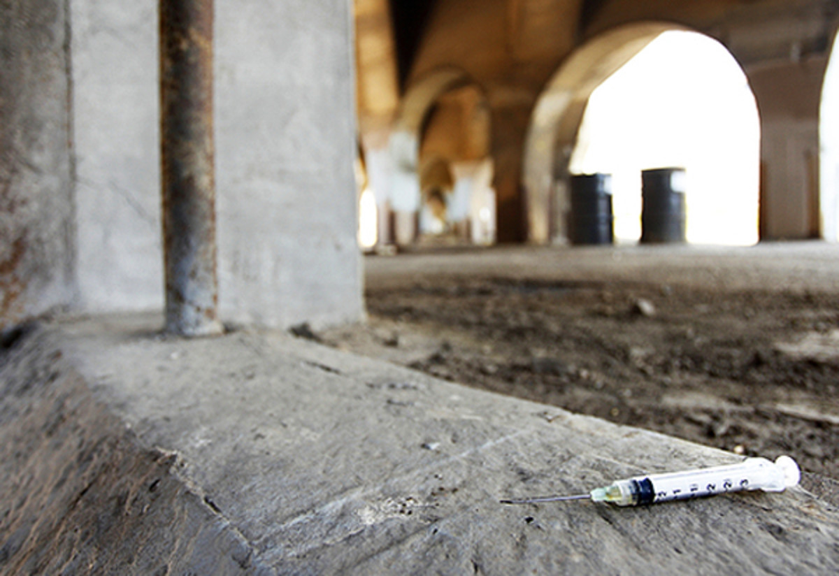 (Syringe on ground image from Peter Kim/ Shutterstock)
